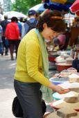 Asian woman in grain market — Stock Photo