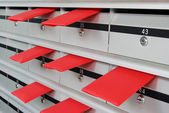 Letterboxes and red envelopes — Stock Photo