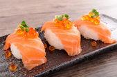 Salmon sushi with caviar — Stock Photo