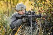 Military soldier shooting an assault rifle — Stock Photo