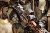 Solder in gloves holding assault automatic rifle — Stock Photo