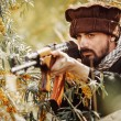 Portrait of serious middle eastern man with gun — Stock Photo #69205523
