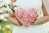 Female hand holding a heart symbol — Stock Photo