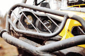 Dirty headlamps ATV in the woods — Stock Photo