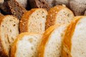 Different types of bread in the basket on the table — Stock Photo