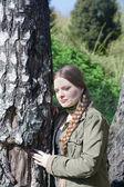 Beautiful girl with long braid — Stock Photo