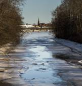 Thawing River with Distant Church — Stock Photo