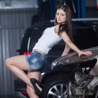 Young and sexy woman in garage — Stock Photo #67223127