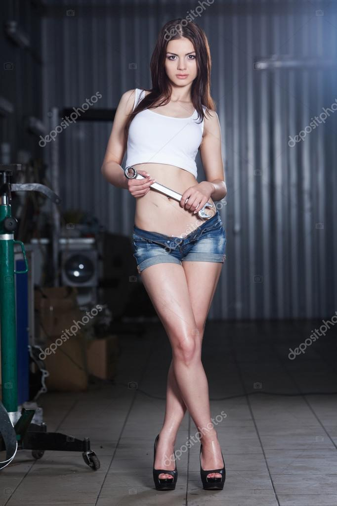 Girl in car repair garage — Stock Photo © romeovip #67223121