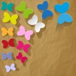 Colorful butterflies on crumpled paper brown background — Stock Vector #71259063