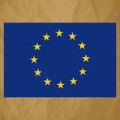 Flag of European Community on a crumpled paper brown background. — Stock Vector