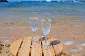 Celebration with two glasses of champagne on the paradise beach — Stock Photo