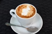 Delicious hot cappuccino on the black background — Stock Photo
