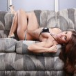 Woman laying on a couch — Stock Photo #62805407