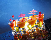 Fruit daiquiri and shooters — Stock Photo