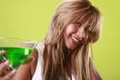 Happy blonde woman with cocktail — Stock Photo