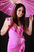 Brunette girl with unbrella — Zdjęcie stockowe
