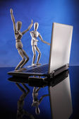 Couple of dummies and  laptop — Stock Photo