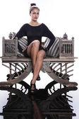 Elegant brunette on vintage chair — Stock Photo