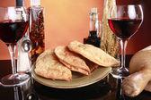 Empanadas, wine, and spices — Stock Photo