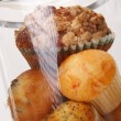Muffins and cupcakes in airtight container — Stock Photo #64586299