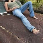 Brunette girl lies on a retro car — Stock Photo #64586969