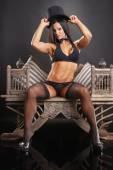 Bodybuilder master of ceremonies on vintage chair — Stock Photo