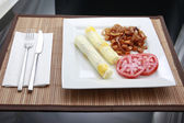 Rolled omelette with grits and tomato — Stock Photo