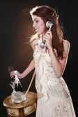 Girl calling on retro phone with Champagne — Stock Photo