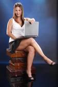 Cute girl with laptop and cigar — Zdjęcie stockowe