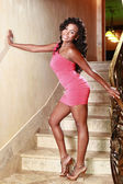 African American girl poses at a stairway — Stock Photo