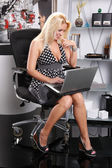 Sexy blonde girl working with laptop — Foto Stock