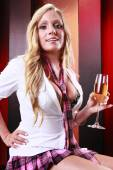 Girl celebrating with a glass of champagne — Stock Photo