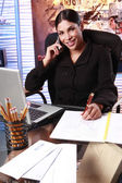 Business woman working at office desk — Stock Photo