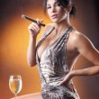 Girl drinks a wine and smokes cigar — Stock Photo #64591641