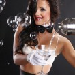 Cute brunette girl serves a martini — Stock Photo #64594755