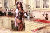 Sexy housewife is preparing in the kitchen — Stock Photo