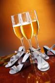 Glasses of wine with shoes — Stock Photo
