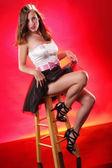 Pretty girl on a stool — Stock Photo