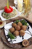Fried Kibbe with Tabouli and Hummus Tahine — Stock Photo