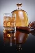 Hard liquor with havana cigar and designer shades — Stock Photo