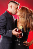Hot young couple with cocktails — Foto de Stock