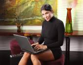 Business woman checks email — Stock Photo