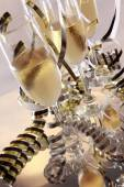 Champagne and curly serpentine — Stock Photo