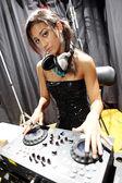 Brunette dj girl — Stock Photo