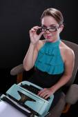 Professional woman and typewriter — Stock Photo