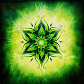 Flower Mandala on a green background  color — Stock Photo