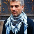 Portrait of a smart  man wearing a scarf — Stock Photo #75043591