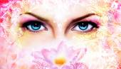 Blue women eyes beaming up enchanting from behind a blooming rose lotus flower, with ornaments — Stock Photo