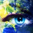 Planet Earth and blue human eye with violet and pink day makeup. Eye painting — Stock Photo #76857013